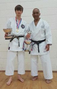 Champion Bradley Williams and Sensei Geoff Cole. Photo by Ian Ford